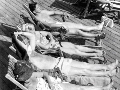 people relax and sunbathe on a cruise ship 1963 - sunbathing stock videos & royalty-free footage