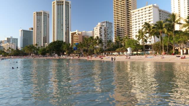 people relax and suntan on the coast in hawaii - hawaii islands stock videos & royalty-free footage