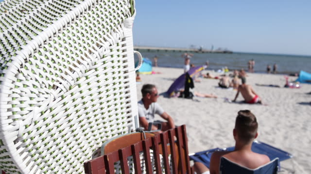 people relax at beach and beach chair at high summer temperatures around 30 degrees celsius during the novel coronavirus crisis on august 13, 2020 in... - sunbathing stock-videos und b-roll-filmmaterial