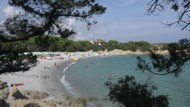 people relax at cala liberotto beach - spiaggia stock videos & royalty-free footage