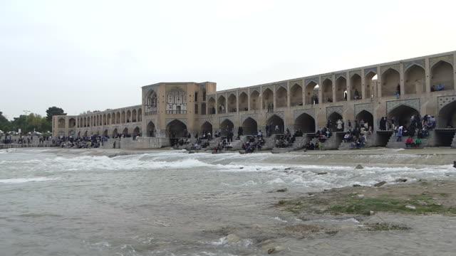 People relax at Khaju bridge, Iran