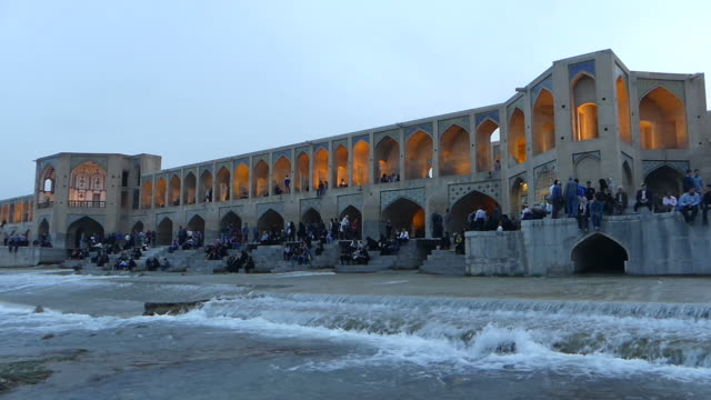 People relax at Khaju bridge, Iran