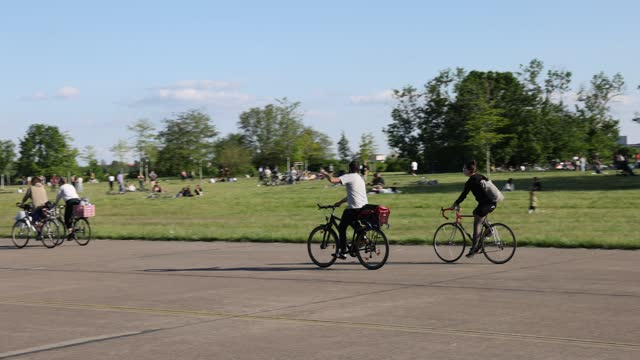 people relax at tempelhofer feld public park during the coronavirus pandemic on may 30, 2021 in berlin, germany. while the pandemic is continuing in... - public park stock videos & royalty-free footage