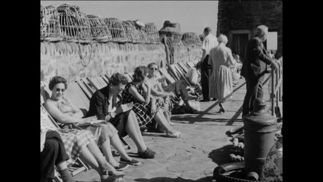 vídeos de stock e filmes b-roll de montage people relax in a seaside resort at a u.k. national park / uk - 1930