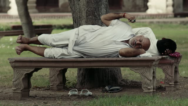 people relax in ornamental gardens in lahore - slipper stock videos & royalty-free footage