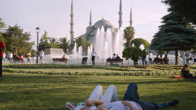 People relax in Sultanahmet Park near Blue Mosque, Istanbul, Turkey