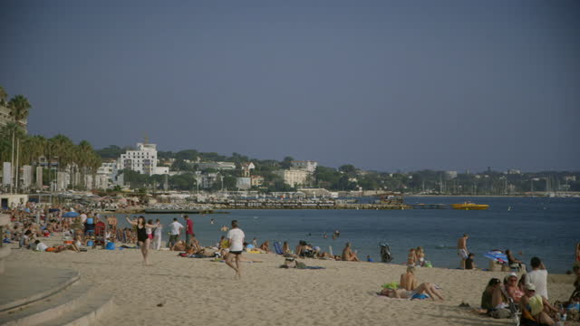 people relax on a beach on the côte d'azur, france - france stock videos & royalty-free footage