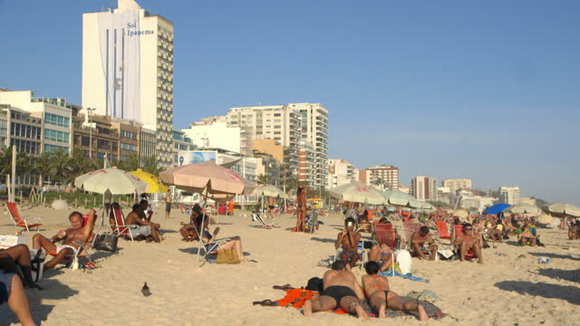 people relax on ipanema beach, brazil - swimming costume stock videos & royalty-free footage