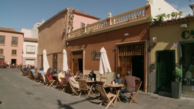 people relaxed at a cafe in tenerife, spain - pavement cafe stock videos and b-roll footage