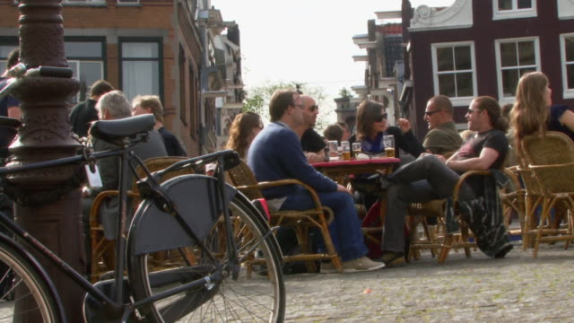 WS people relaxing and drinking in Leliegracht, Amsterdam