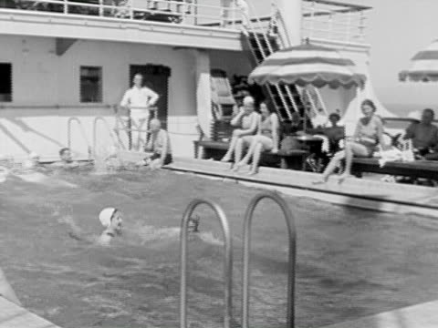 1934 b/w montage la ms pan ha ws people relaxing around and swimming in swimming pool on board of cruise ship, people playing board and card games in games room, men playing table tennis and mini golf on ship deck / gulf of mexico - golfschläger stock-videos und b-roll-filmmaterial