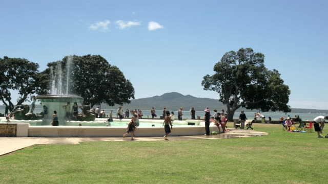 t/l, ms, people relaxing at fountain, mission bay, auckland, north island, new zealand - auckland stock videos & royalty-free footage