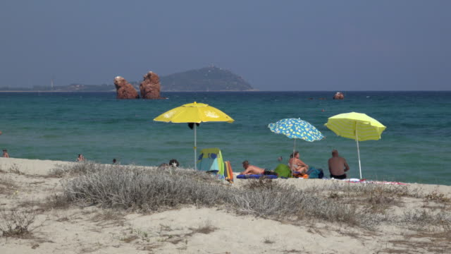 people relaxing at lido di cea beach - spiaggia stock videos & royalty-free footage