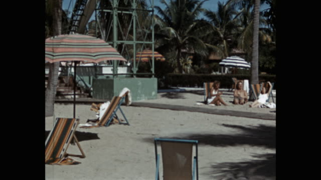 people relaxing at resort, florida, usa - deckchair stock videos & royalty-free footage