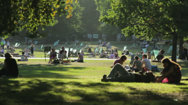 ws people relaxing at st james's park, westminster, london, england - lying down stock videos & royalty-free footage