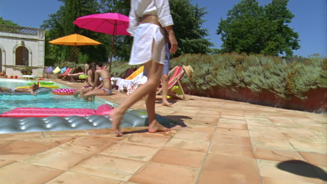 ws, pan, cs, people relaxing at swimming pool, saint ferme, gironde, france - gironde stock videos and b-roll footage