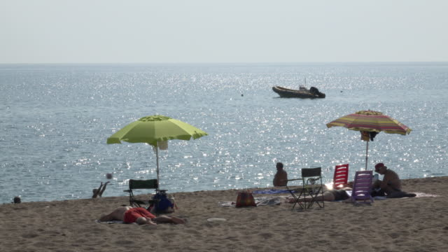 people relaxing at torre di bari beach - spiaggia stock videos & royalty-free footage