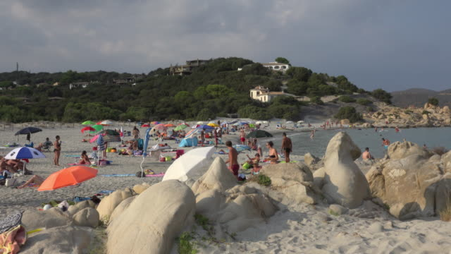 people relaxing at villasimius beach - spiaggia stock videos & royalty-free footage