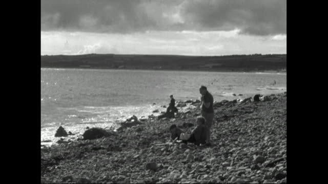 people relaxing on a stony beach in cornwall;1951 - 1951 stock videos & royalty-free footage