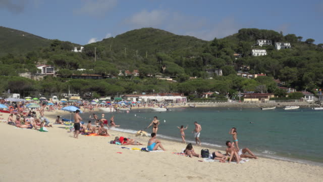 people relaxing on beach at marina di campo - island of elba stock videos & royalty-free footage