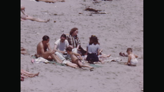 vídeos de stock, filmes e b-roll de ms people relaxing on beach / avila beach, california, united states - toalha de praia