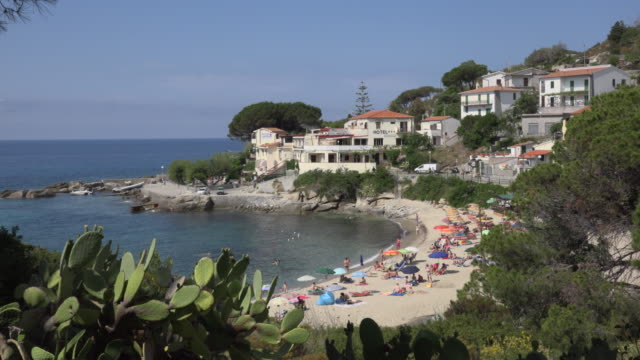 people relaxing on beach of seccheto - island of elba stock videos & royalty-free footage