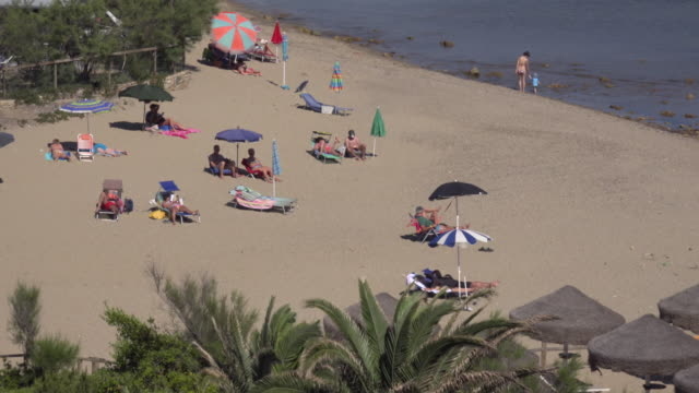 people relaxing on lacona beach - island of elba stock videos & royalty-free footage