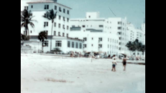 people relaxing on miami beach from a tourist pov - miami dade county stock videos and b-roll footage