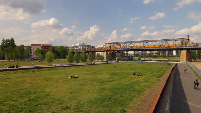 people relaxing on park in berlin summer in front of a train - natural parkland stock videos & royalty-free footage