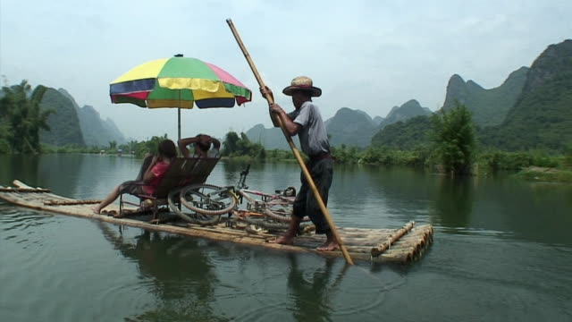 ws pov people relaxing on raft, yangshuo, guangxi, china - yangshuo stock videos & royalty-free footage