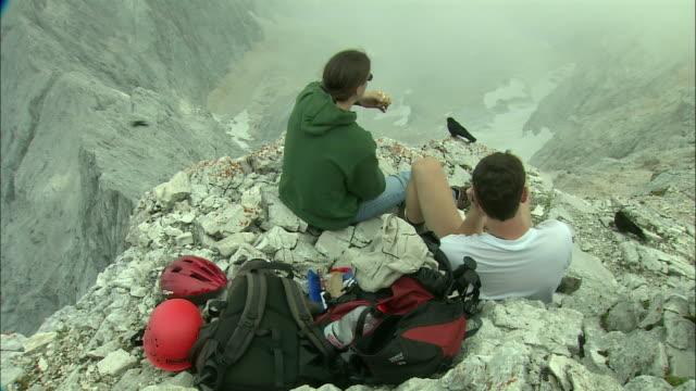 MS HA PAN People relaxing on Zugspitze mountain peak, Bavaria, Germany