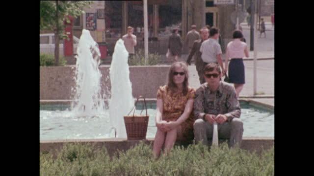 people relaxing outside in east berlin streets; 1970 - germany stock videos & royalty-free footage