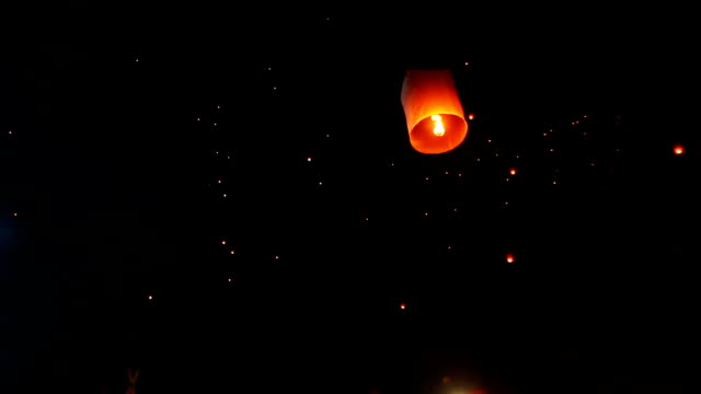 people release lantern in the sky - sky lantern stock videos & royalty-free footage