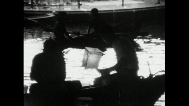 people release paper lanterns on hiroshima river; 1966 - weapons of mass destruction stock videos & royalty-free footage