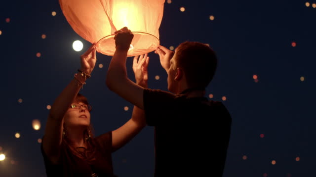 people release paper lanterns, poland - ランプ点の映像素材/bロール
