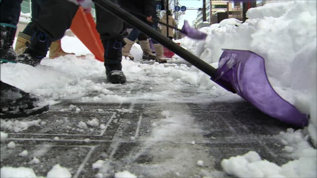 people removing snow side by side their feet - side by side stock videos & royalty-free footage