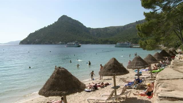 MS People resting on beach / Pollenca, Mallorca, Spain