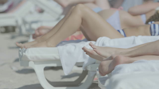ms people resting on sun lounger at beach / antibes, france - sun lounger stock videos & royalty-free footage