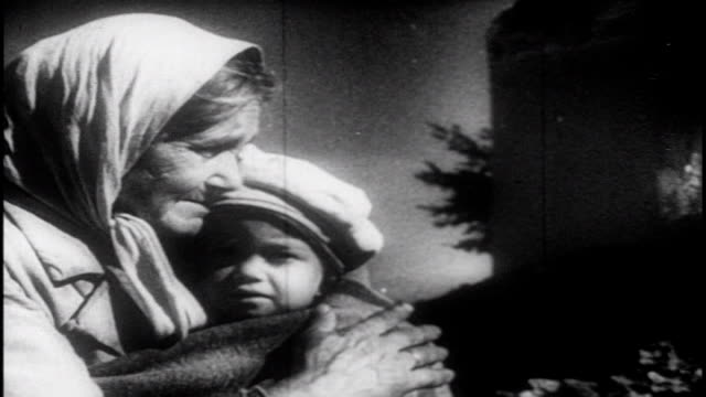 people return to the village they lived in during the battle of kursk lay flowers at a memorial and reunite with family members footage for soviet... - propaganda stock-videos und b-roll-filmmaterial