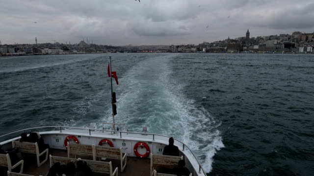 people ride a ferry across the bosphorus strait between the european and asian sides of istanbul on february 16, 2016 in istanbul, turkey. - ferry ride stock videos & royalty-free footage