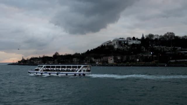 People ride a ferry across the Bosphorus Strait between the European and Asian sides of Istanbul on February 16 2016 in Istanbul Turkey