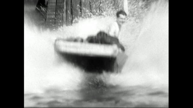 people ride log flume and splash into the water;1951 - 1950 stock videos & royalty-free footage