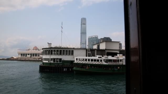 People ride on a Star Ferry on Victoria Harbour between Hong Kong Island and the Kowloon Peninsula in Hong Kong on March 20 2013 in Hong Kong Hong...