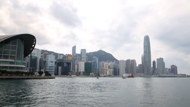 people ride on a star ferry on victoria harbour between hong kong island and the kowloon peninsula in hong kong on march 20, 2013 in hong kong, hong... - ferry ride stock videos & royalty-free footage