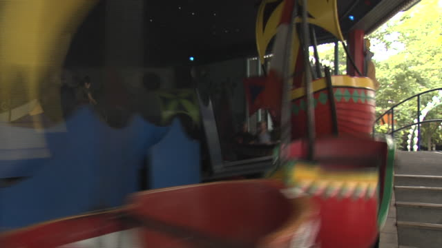 people ride one of the attractions in copenhagen's tivoli gardens. - tivoli copenhagen stock videos and b-roll footage