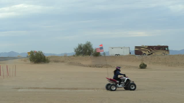 people riding atv in the sand dune park amid the 2019 coronavirus pandemic. - dirt track stock videos & royalty-free footage
