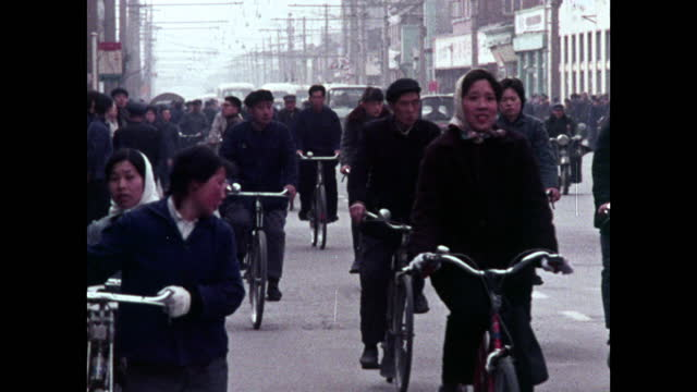 ws people riding bicycles in mao suits in beijing; 1973 - maoism stock videos & royalty-free footage