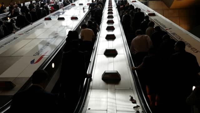 People Riding Escalator in London Underground Station