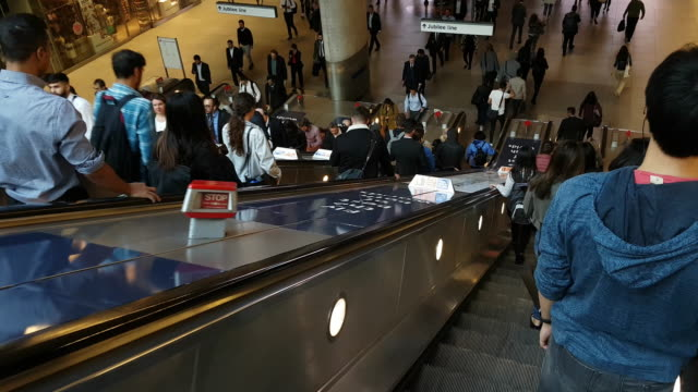 people riding escalator in london underground station - walking point of view stock videos and b-roll footage