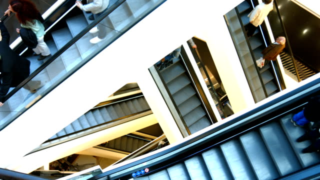 ha people riding escalator in modern shopping mall - escalator stock videos & royalty-free footage